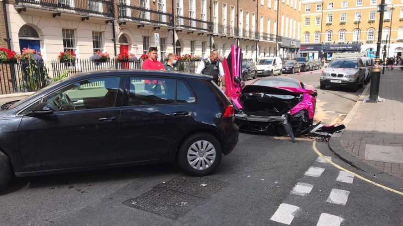 hot-pink-mclaren-570s-supercar-crashed-into-a-vw-golf